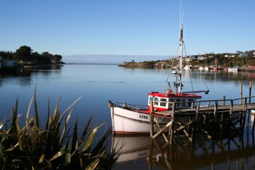 Find relaxed coastal townships in Western Southland