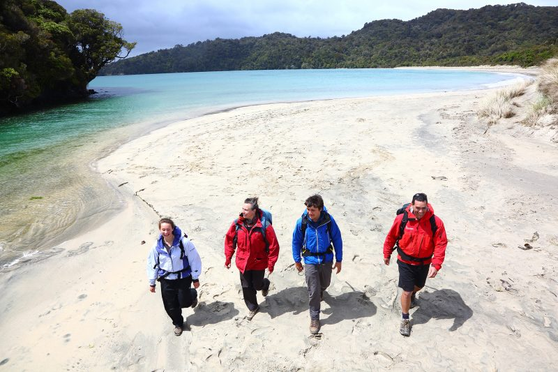Hikers on Maori Beach, Rakiura Track